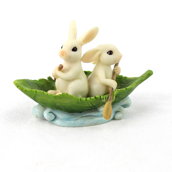 fairy garden accessories: two bunnies in a leaf boat